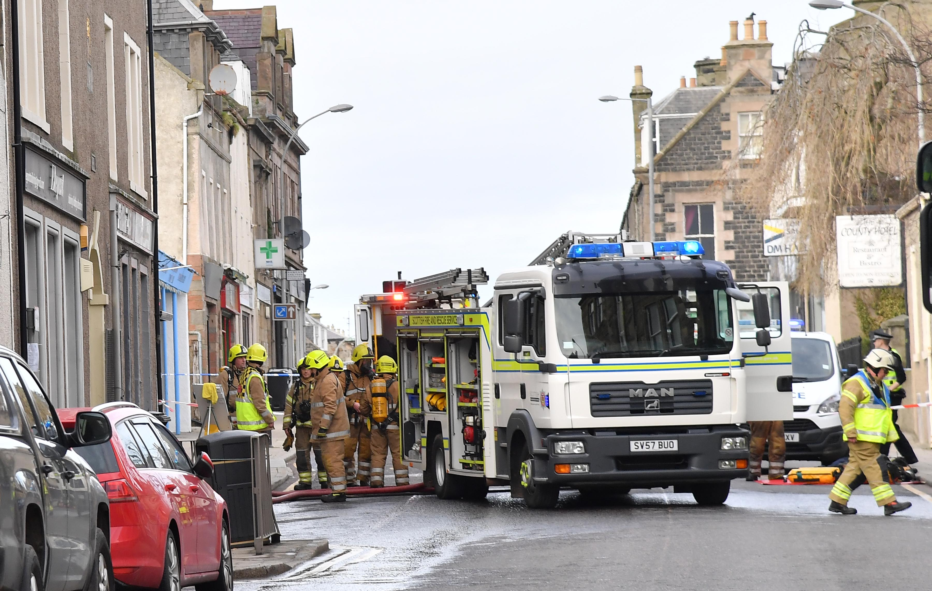 Emergency crews at the scene following a fire on High Street, Banff yesterday.