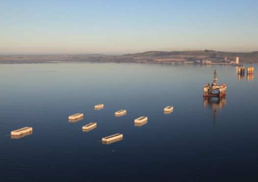 The first of the 22 concrete caissons has left Cromarty Firth on a 180-nautical mile journey to Aberdeen harbour.