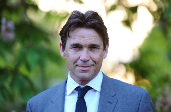Actor Dougray Scott has spoken about his father's Parkinson's disease.