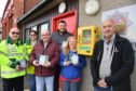 Members of the Fraserburgh and district community safety with the new defibrillators which were purchased after £9,000 in funding was secured. L to R: Douglas Ewen, Colleen Ewen, Brian Noble, Chris Arnott, Claire Levett and chairman John Anderson.  PIC: Duncan Brown