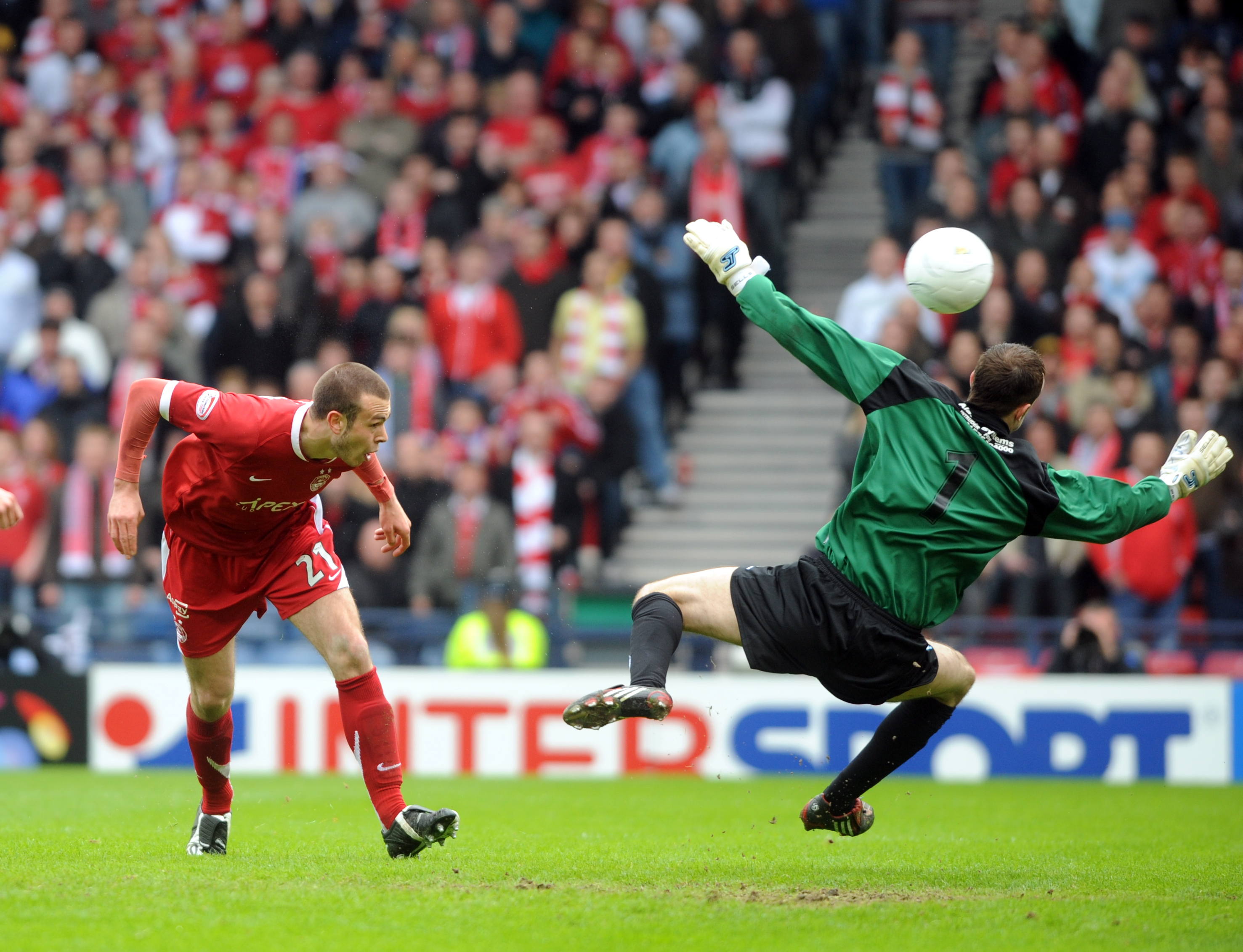 Andy Considine nets the second goal against Queen of the South in 2008.