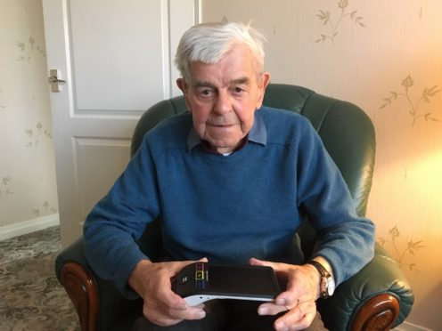 Harry Black with his electronic magnifier.