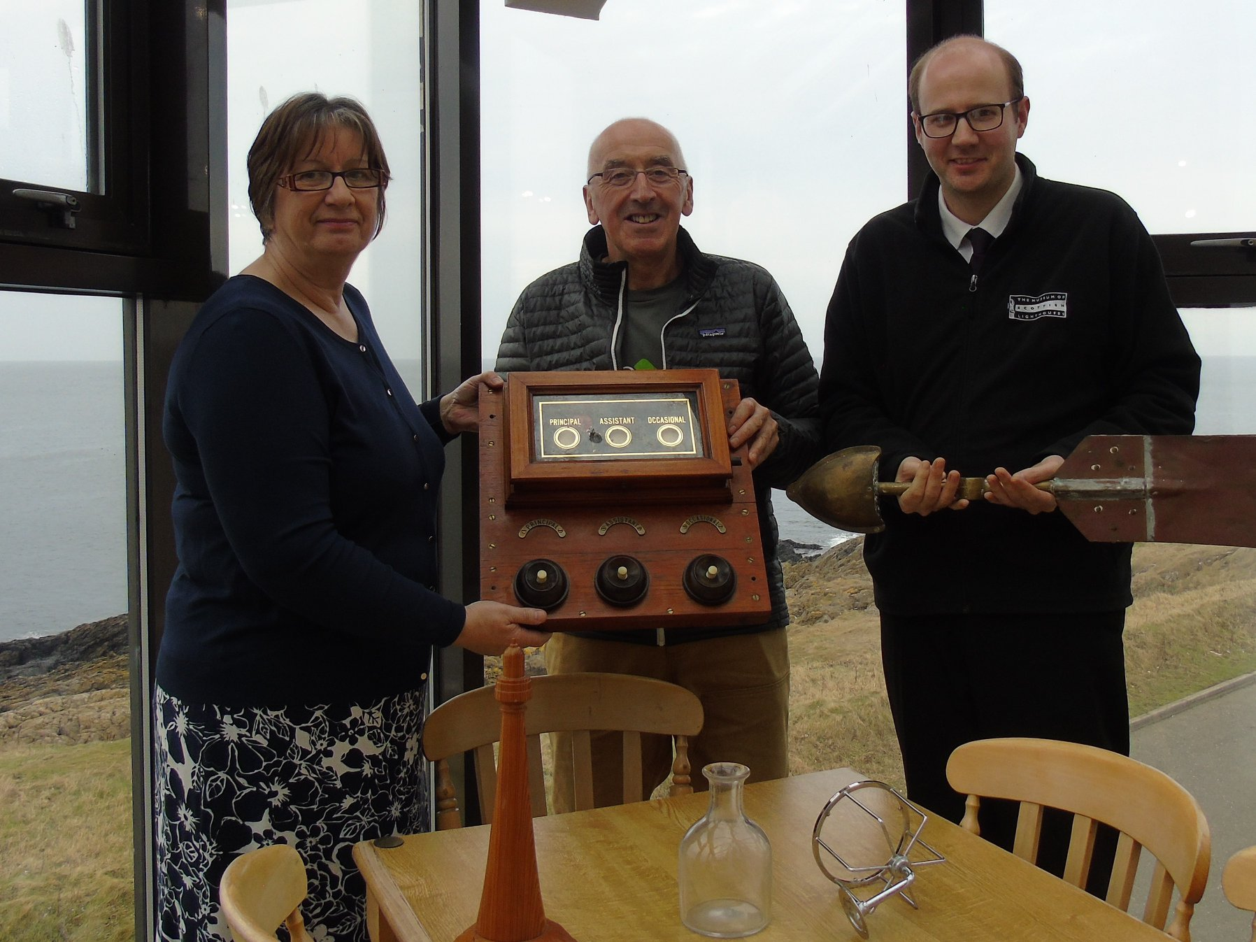 L-R: museum manager Lynda McGuigan, Calum Falconer and collections manager Michael Strachan.