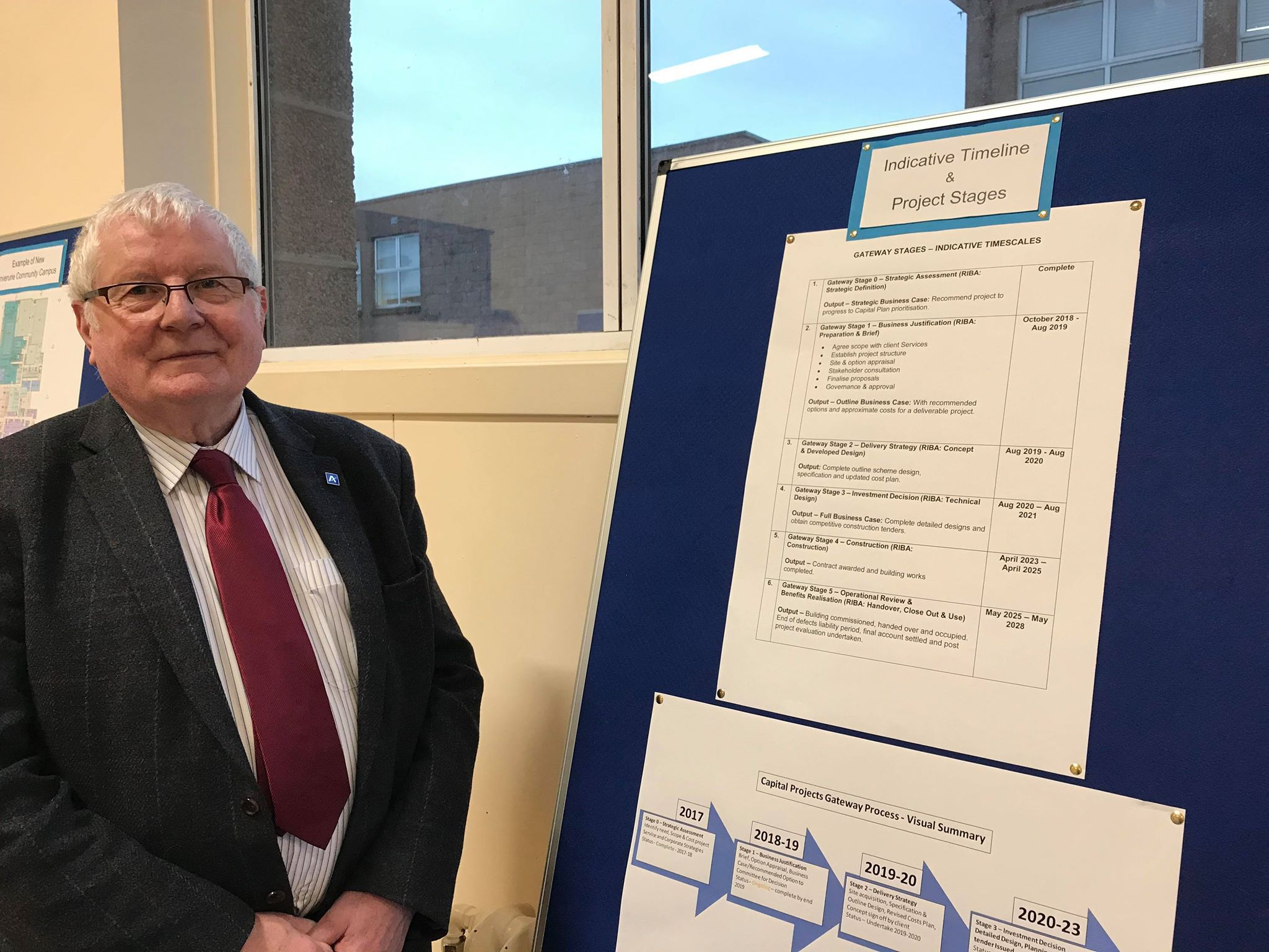 Councillor Norman Smith with the indicative time line of the Peterhead community campus.