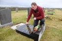 Grandson Steven Sinclair of David and Anna Sincliair who's grave stone was toppled on the instructions of the Orkney Islands Council as part of their Health and Safety concerns.