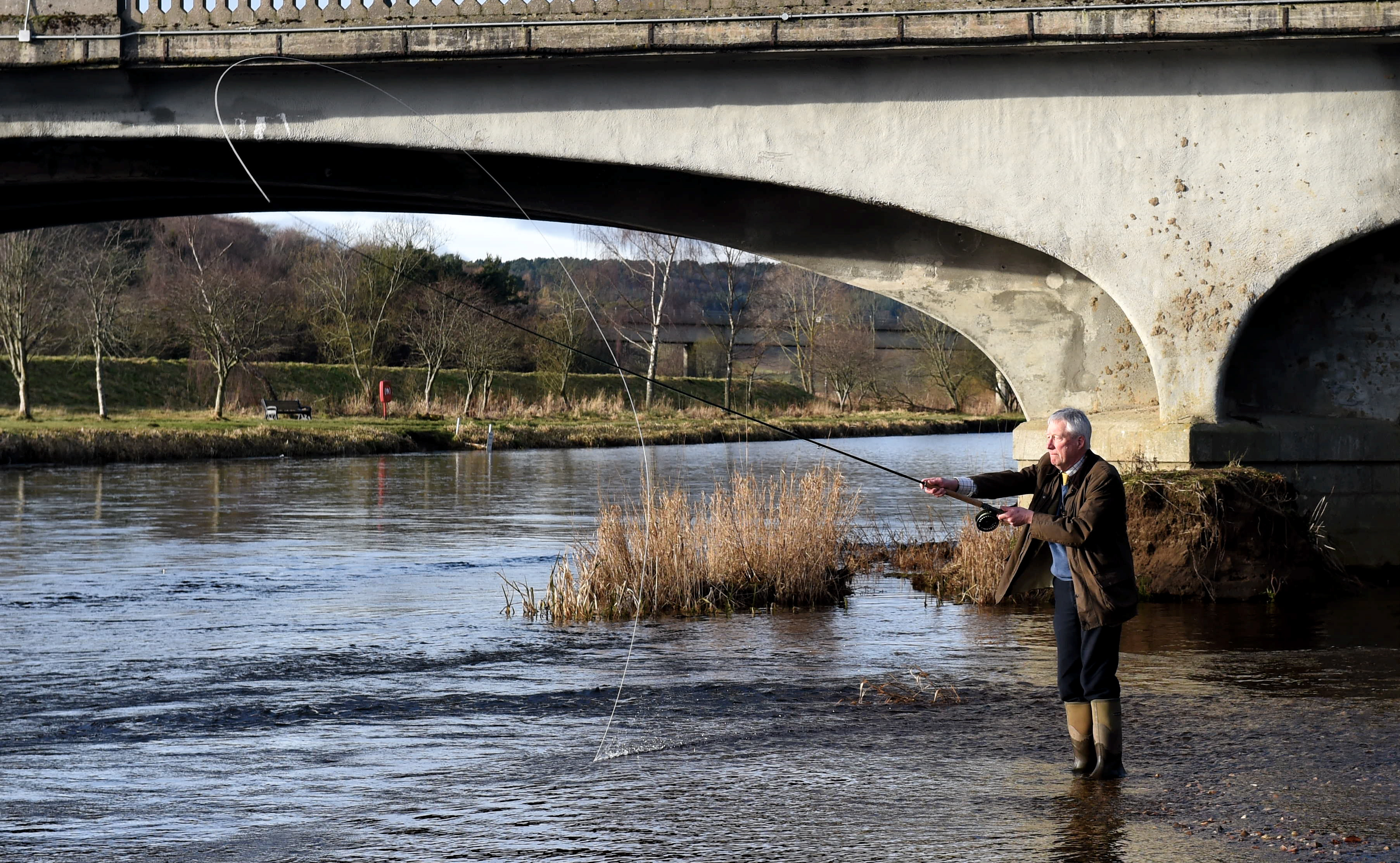 Aberdeenshire Provost Bill Howatson makes the first official cast of the season at Port Elphinstone.