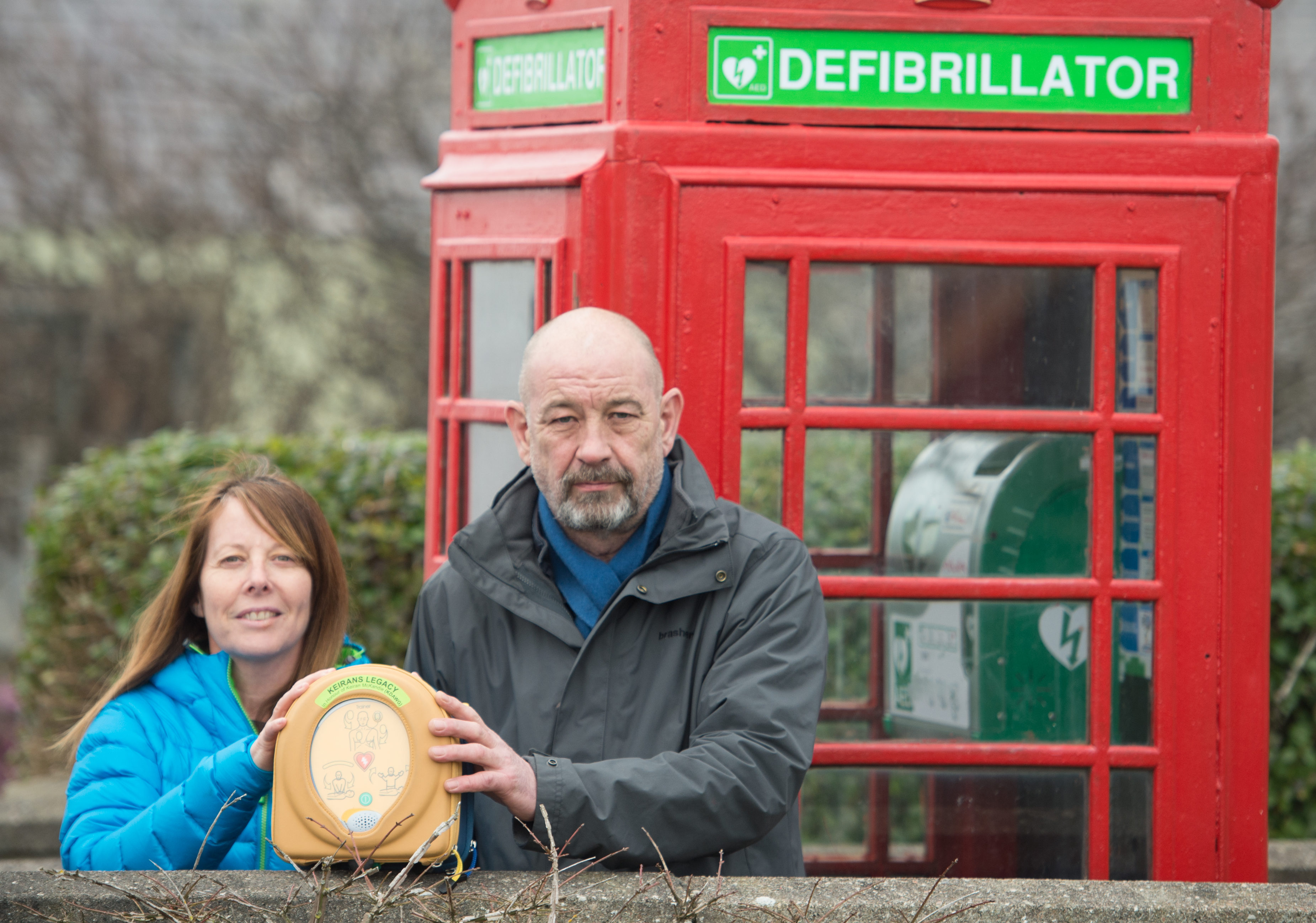 Sandra McKandie (chairwoman of Keiran's Legacy) and Roddy Robertson at Garmouth's new defibrillator telephone box.