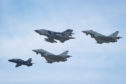 Tornados make a final fly pass RAF Lossiemouth accompanied by Typhoons and a trainer craft.