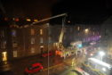 Scottish Fire and Rescue Service at the scene of a flat fire on Richmond Street, Aberdeen.