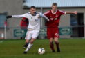 Jaime Wilson (left) playing for Rothes.