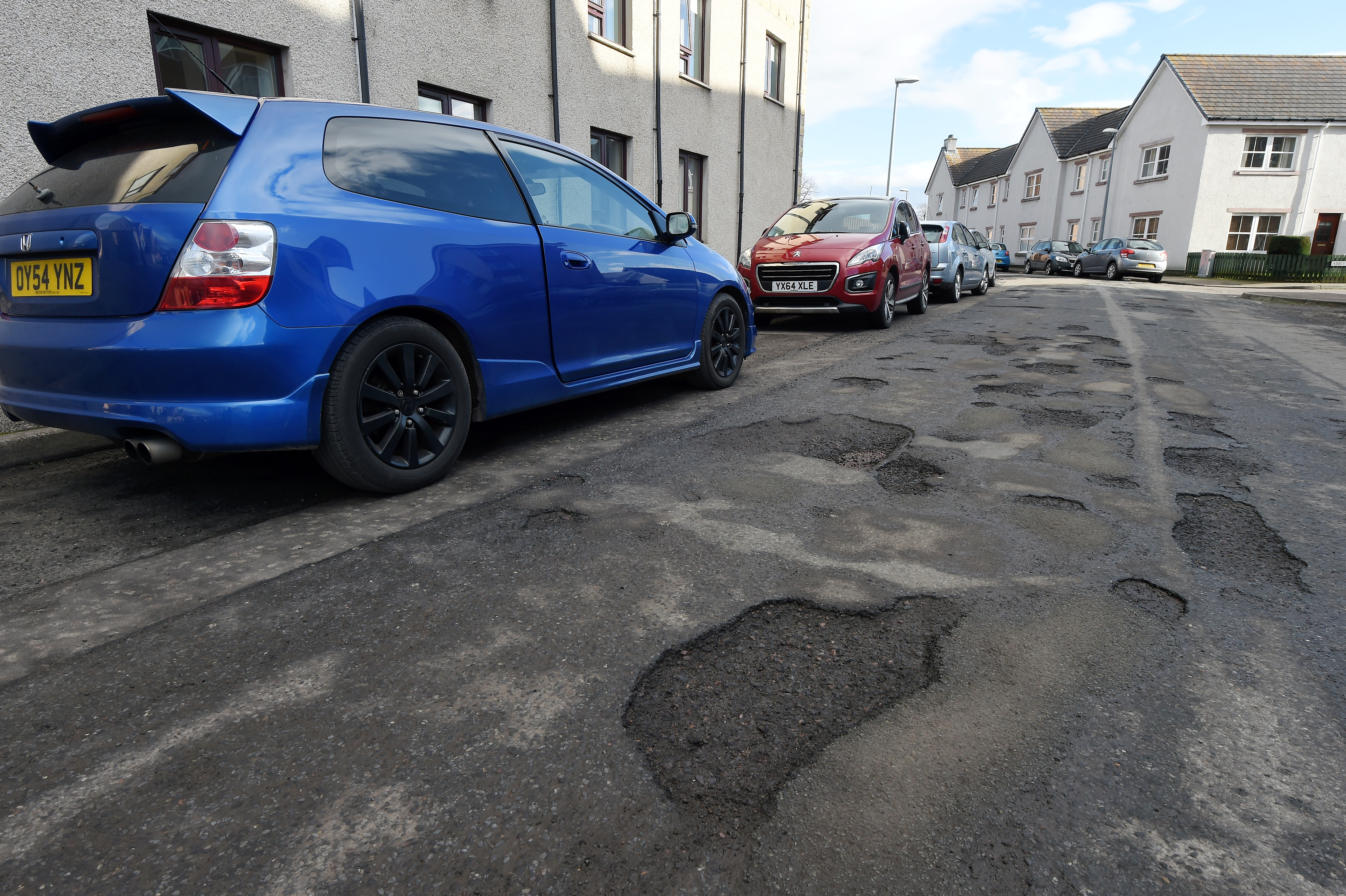 Dunabban Street in Invernes which is riddled with potholes.