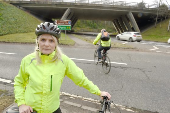 Inverness cyclist Susan Mccreadie at the Raigmore Interchange pedestrian crossing where a pedestrian was seriously injured in a collision with a car earlier this week.