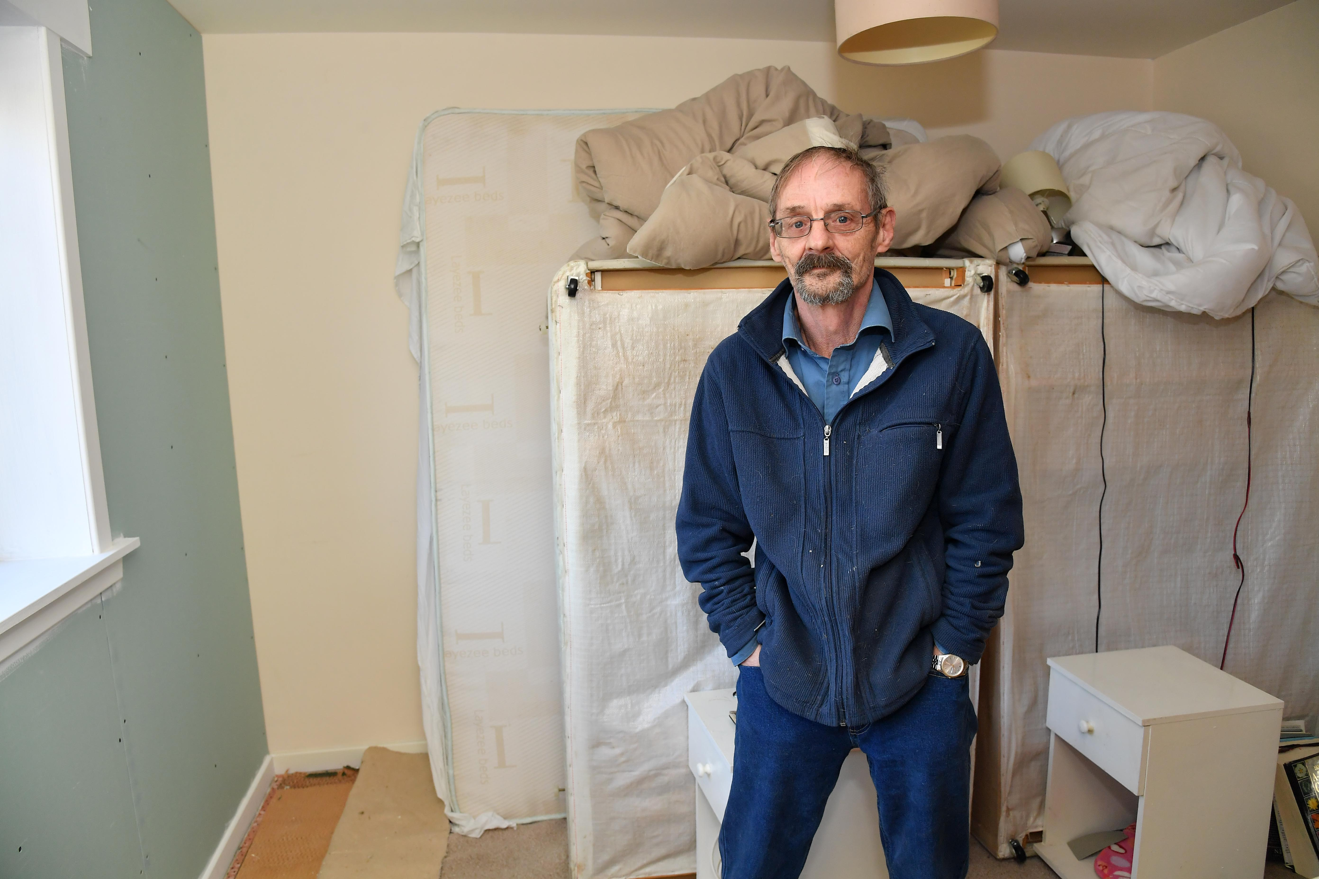 KEVIN BAXTER CAN'T USE HIS BEDROOM UNTIL WORKS TO CORRECT A DAMP PROBLEM ARE COMPLETED.