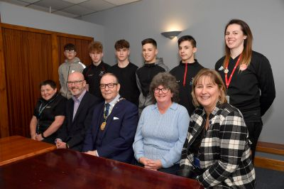 At the celebration of the PeterDeen scheme in February earlier this year are (seated L to R) Lynne Gordon, senior community learning worker, Ally Prockter, CEO, Aberdeen FC community trust, councillor Ron McKail, deputy provost, councillor Gillian Owen and Shona Sellers, Peterhead Academy head teacher. (Rear L to R) Pupils Aiden Whyte, Lewis Buchanan, Aidan Hendry, Kieran Smith, Jacob Knight and Lois Walker, community projects officer.