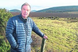 Black Isle councillor Gordon Adam at an area of land off the Allangrange road near Munlochy.
