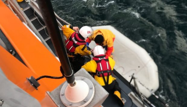 Ian Mackay being brought aboard the Buckie lifeboat.
