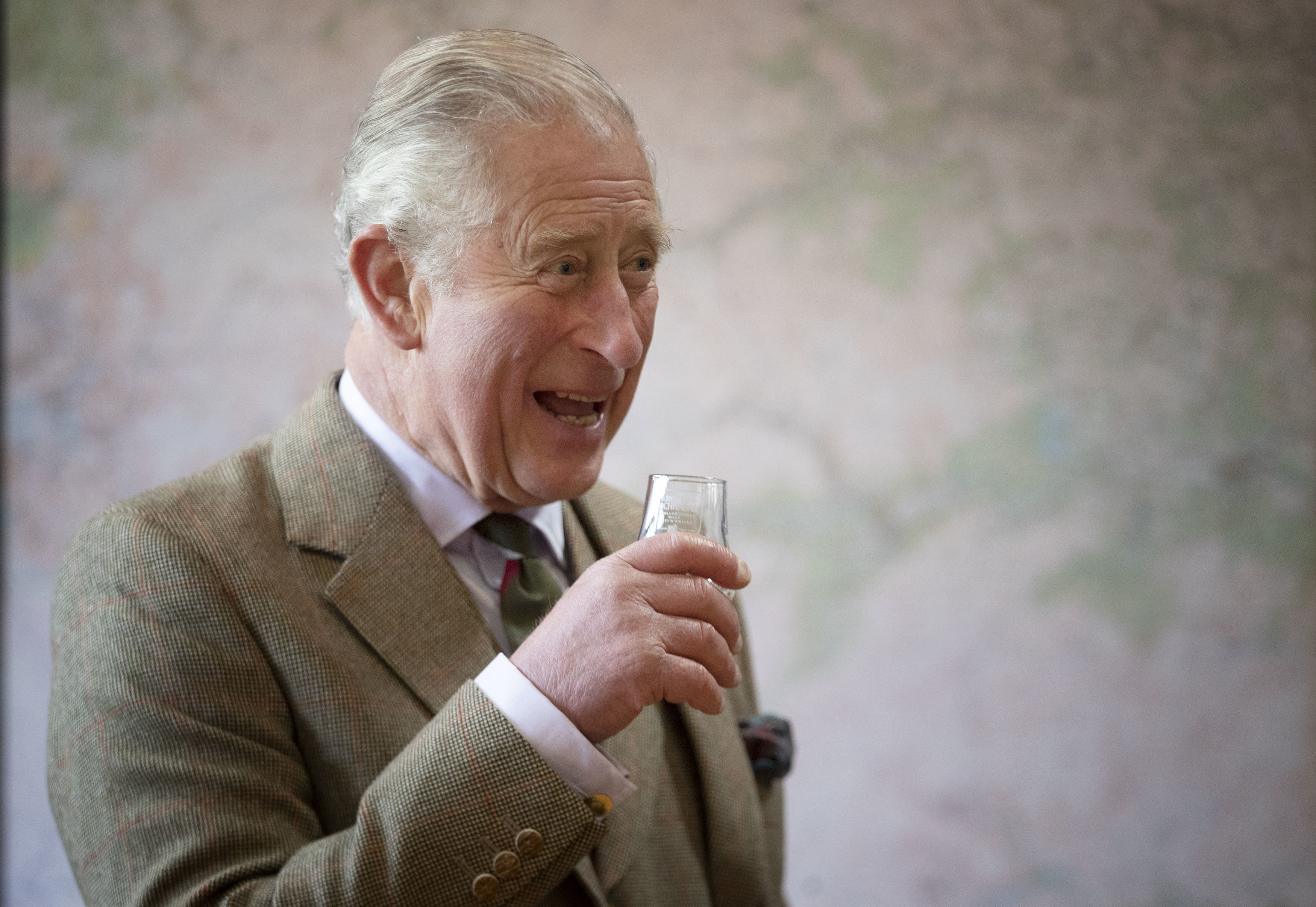 The Prince of Wales, known as the Duke of Rothesay while in Scotland, takes part in a whisky tasting during a visit to the Royal Lochnagar Distillery at Crathie.