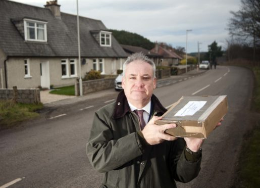 MSP Richard Lochhead, visit's the small collection of houses in the Orton aria near Fochabers, it borders the IV and AB postcodes, and is considered to be the edge of mainland Scotland by post and courier services even though it is in the heart of Moray.     Photo by Michael Traill 9 South Road Rhynie Huntly AB54 4GA  Contact numbers Mob07739 38 4792 Home01464 861425
