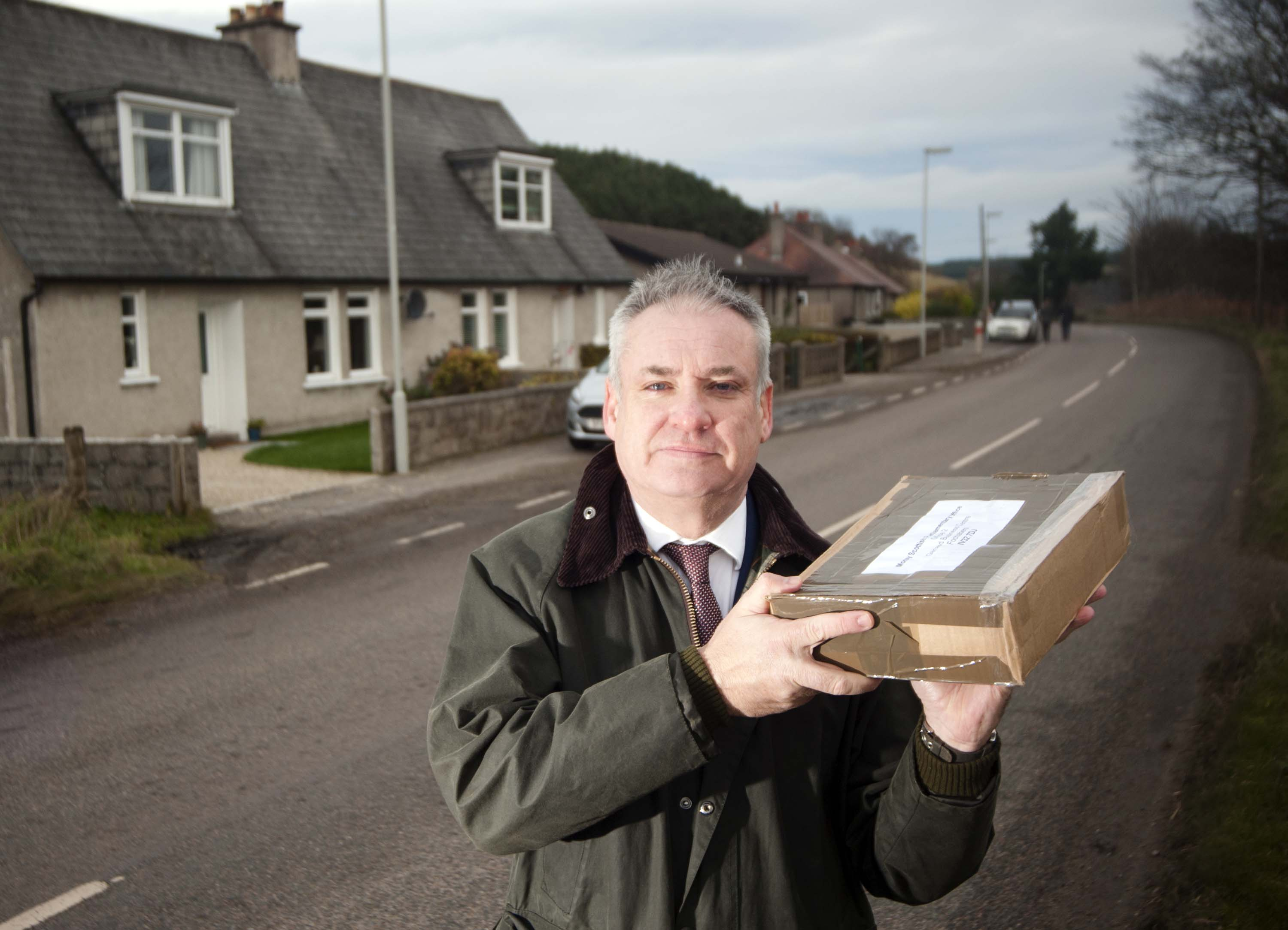MSP Richard Lochhead, visit's the small collection of houses in the Orton aria near Fochabers, it borders the IV and AB postcodes, and is considered to be the edge of mainland Scotland by post and courier services even though it is in the heart of Moray.     Photo by Michael Traill						 9 South Road Rhynie Huntly AB54 4GA  Contact numbers Mob	07739 38 4792 Home	01464 861425