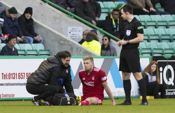 Sam Cosgrove limped off with a back injury.