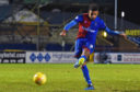Nathan Austin rolls home the decisive penalty.