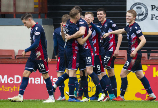 Ross Stewart is congratulated after putting Ross County in front.