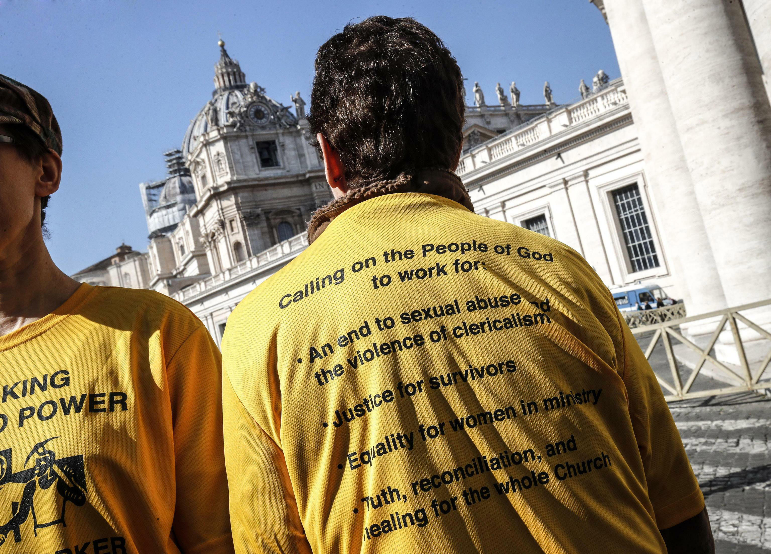 Demonstrators wear shirts as they stand outside St. Peter's Square on the day of the opening of a sex abuse within the Catholic church prevention summit, at the Vatican, Thursday, Feb. 21, 2019.  Pope Francis opened a landmark sex abuse prevention summit Thursday by warning senior Catholic figures that the faithful are demanding concrete action against predator priests and not just words of condemnation. (Giuseppe Lami/ANSA via AP)