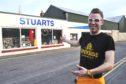 Seb Jones outside Stuarts Cycle Shop