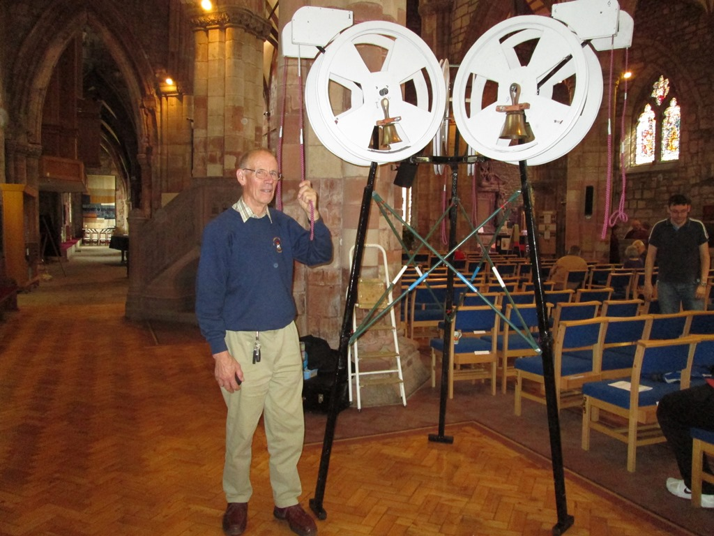 Mike Neale with a set of mini bells at Haddington Church.