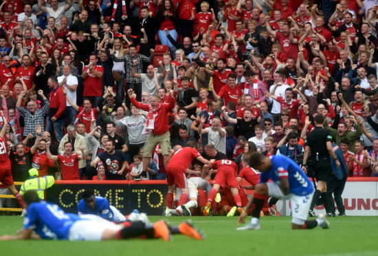 Aberdeen players celebrating after Bruce Anderson equalises at Pittodrie on the opening day in August 2018. Picture by Darrell Benns.