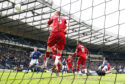 Steve Tosh (bottom right) squeezes the ball through the crowded Aberdeen box to put his side in front