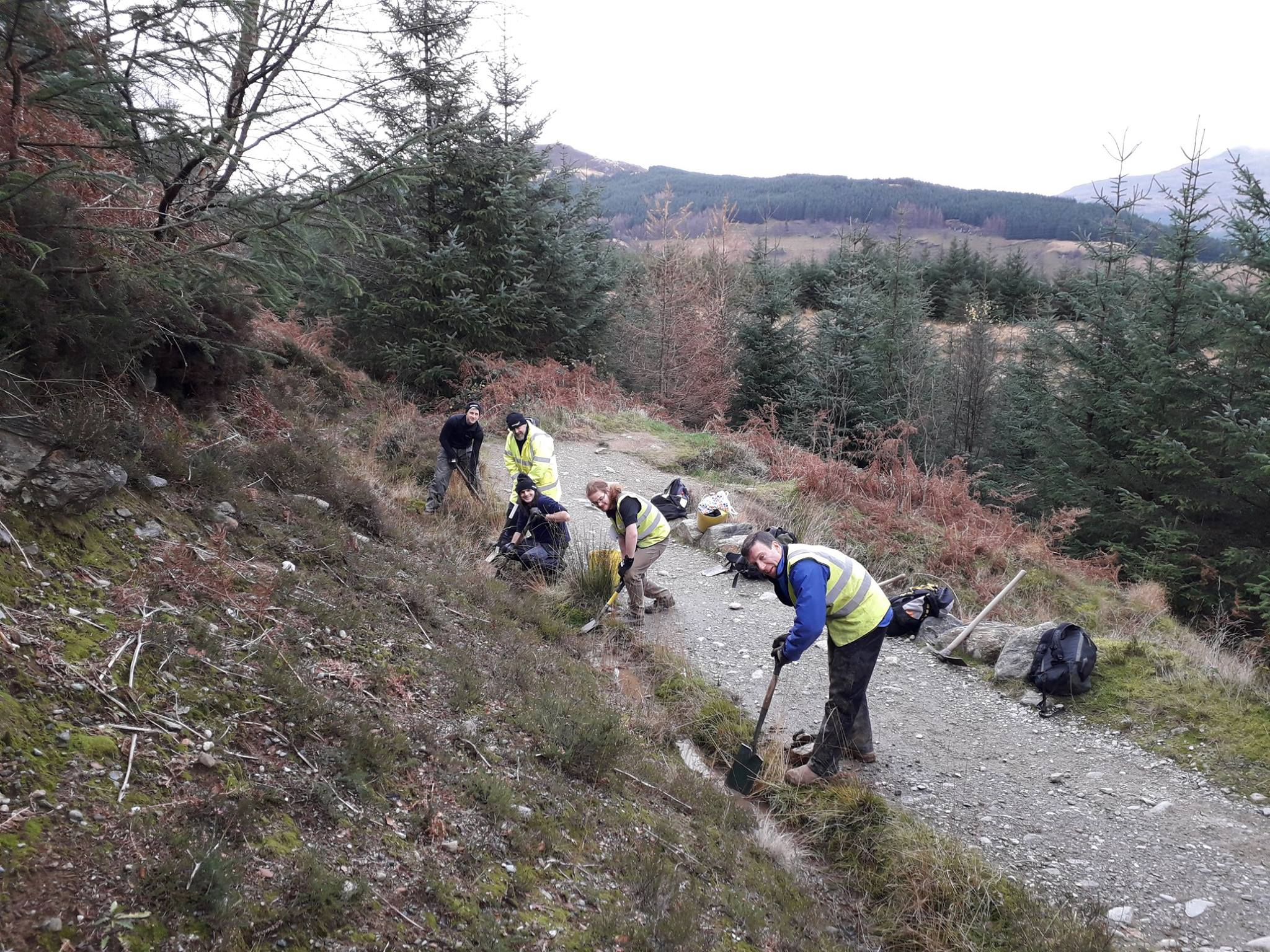 Volunteers from The Mountains and The People repairing mountain paths.