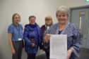 Left to right is council officer Marion Mackay who presented the proposal, local bus user Helen Blanchett, Turriff Business Association chairwoman Marjory Chalmers and councillor Anne Stirling who chaired the meeting and accepted a petition from residents to keep the timetabled bus route