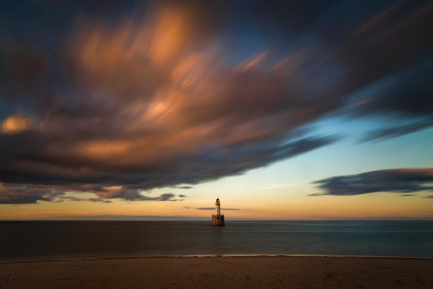 Rattray Head Lighthouse in sunset light, east coast of Scotland