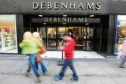 File photo dated 18/03/11 of a Debenhams store. A surge in sales in the final week before Christmas helped the department store chain weather tough autumn trading today. PRESS ASSOCIATION Photo. Issue date: Tuesday January 10, 2012. The company, which has 170 stores in the UK, Ireland and Denmark, said warmer weather throughout October and November impacted sales until a record Christmas week left trading for the 18 weeks to January 7 level on a year ago. See PA story CITY Debenhams. Photo credit should read: Dave Thompson/PA Wire
