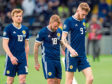 (Left-Right) Scotland's Stuart Armstrong, Johnny Russell and Oli McBurnie trudge off the field at full-time.