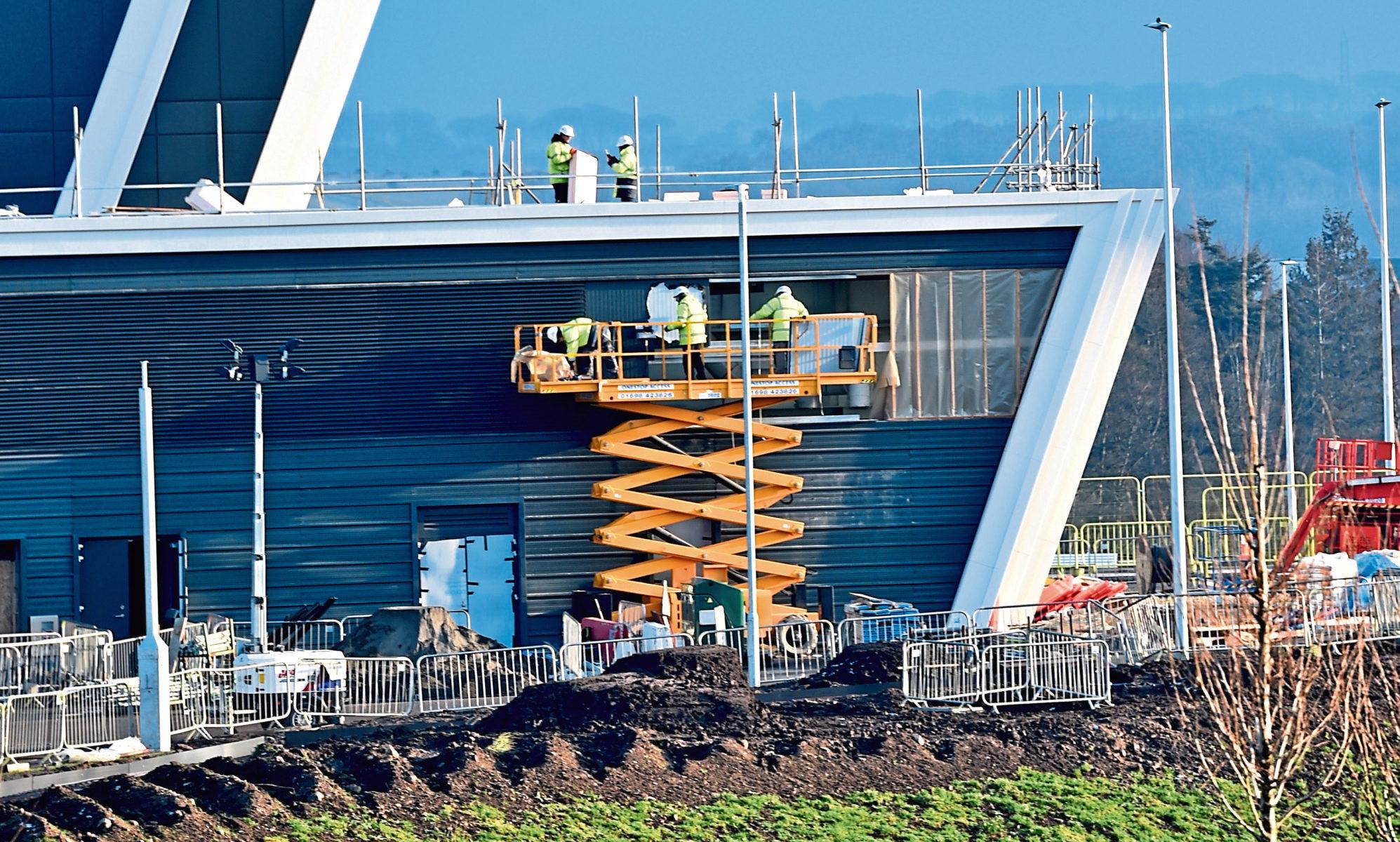 Workmen on the TECA development. Picture by Colin Rennie