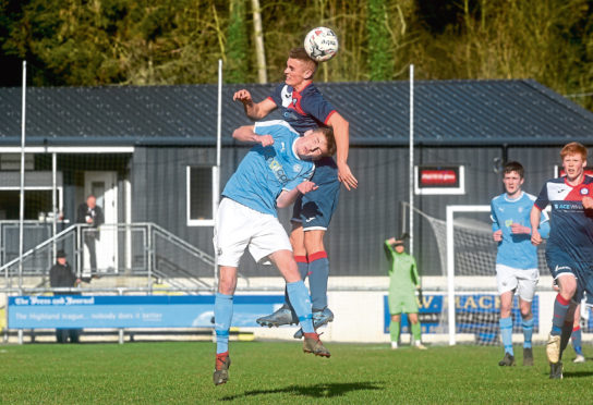 Turriff United (Navy) v Nairn (light blue) Highland League Pictured are Nairn's Cohen Ramsay and Turriff's Angus Grant. Picture by DARRELL BENNS