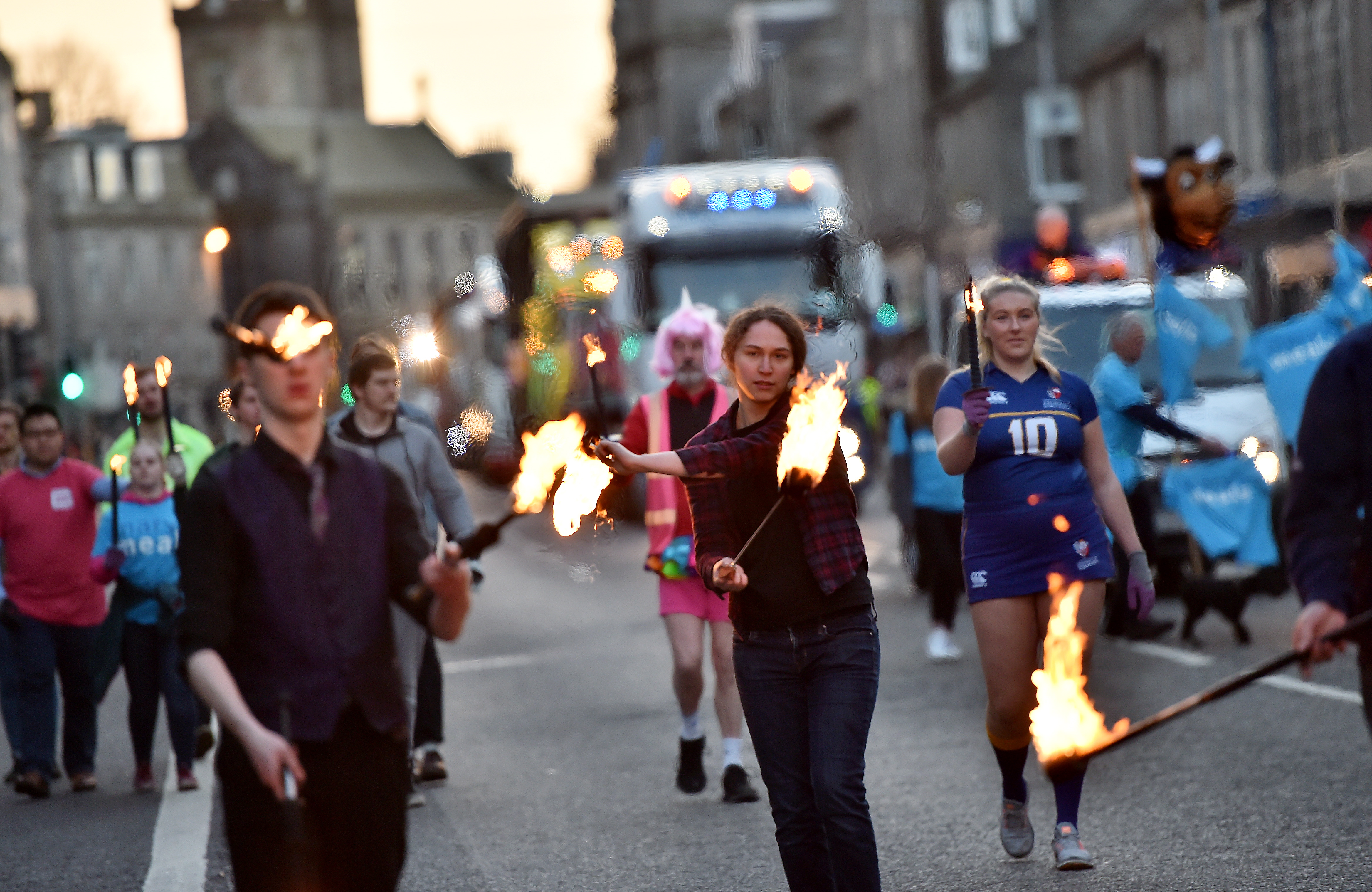 The torcher parade raised cash for charity