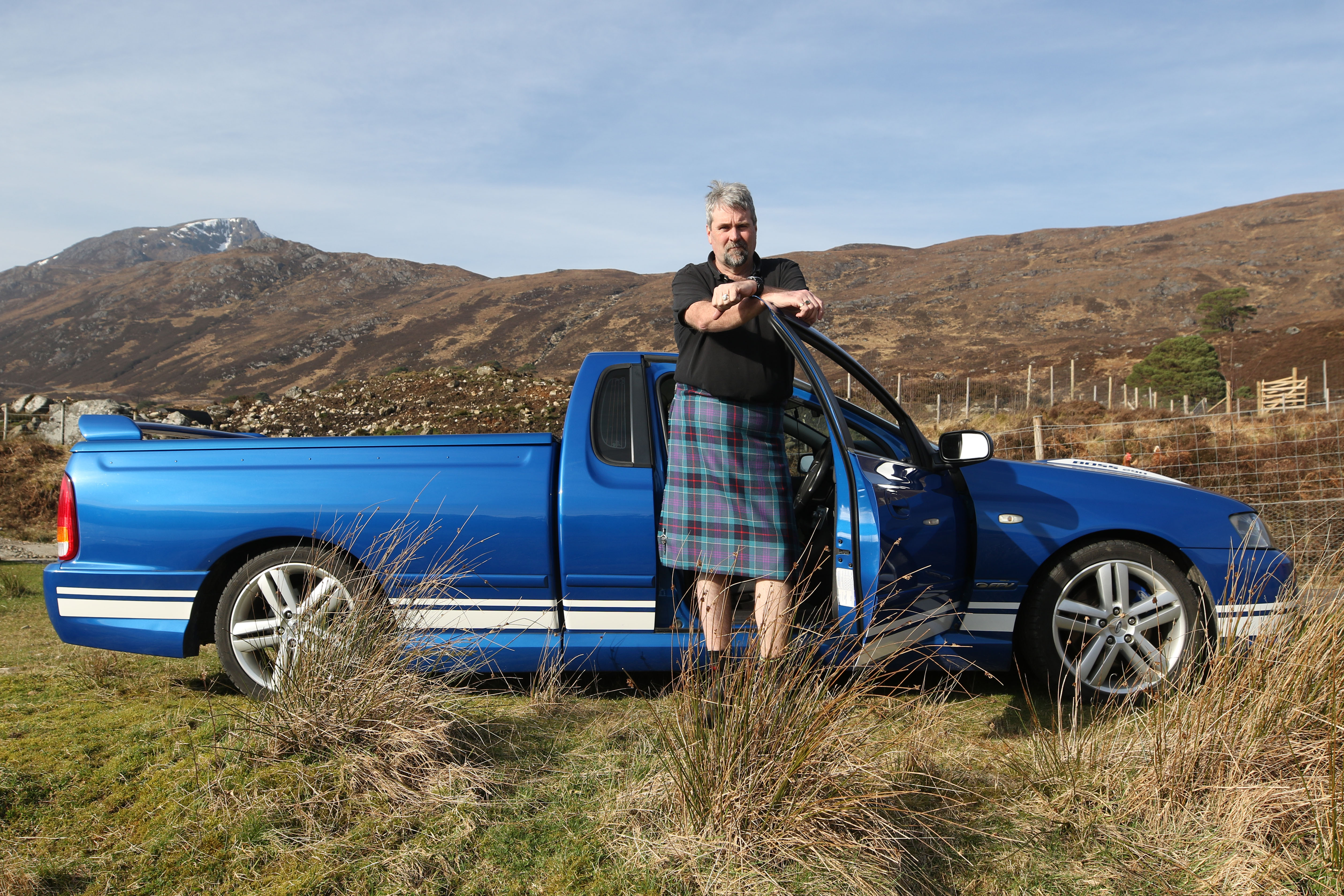 Brad Collins with his Ford FPV BA MkII Pursuit, photographed in Glen Affric.