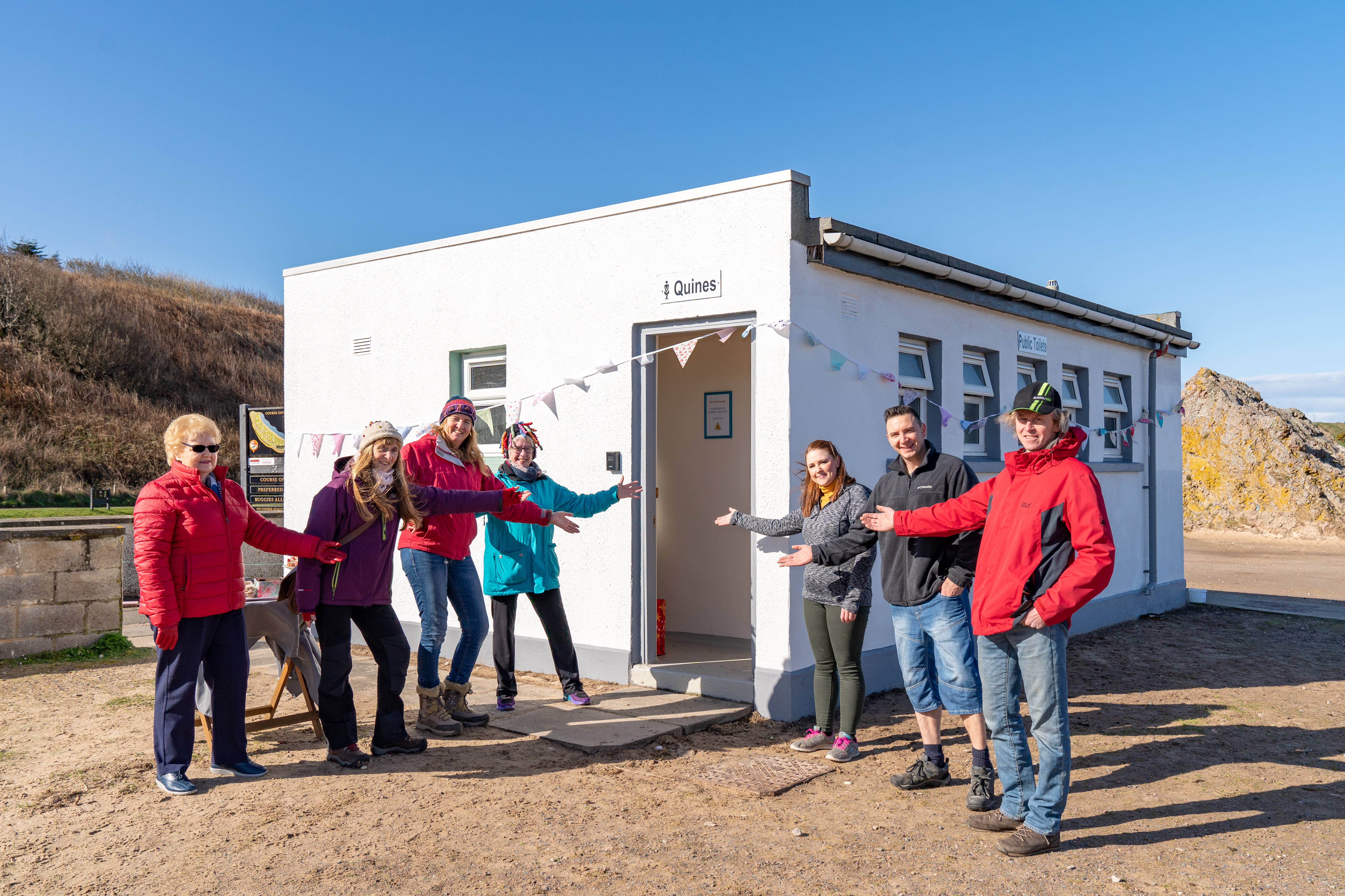 Cullen volunteers are the grand re-opening of their toilets