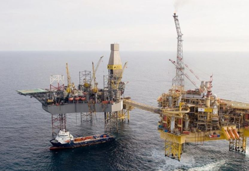 Total's Elgin PUQ platform, pictured right, alongside a Rowan rig.