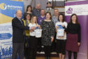 University staff have raised over £5000 to benefit Befrienders Highland