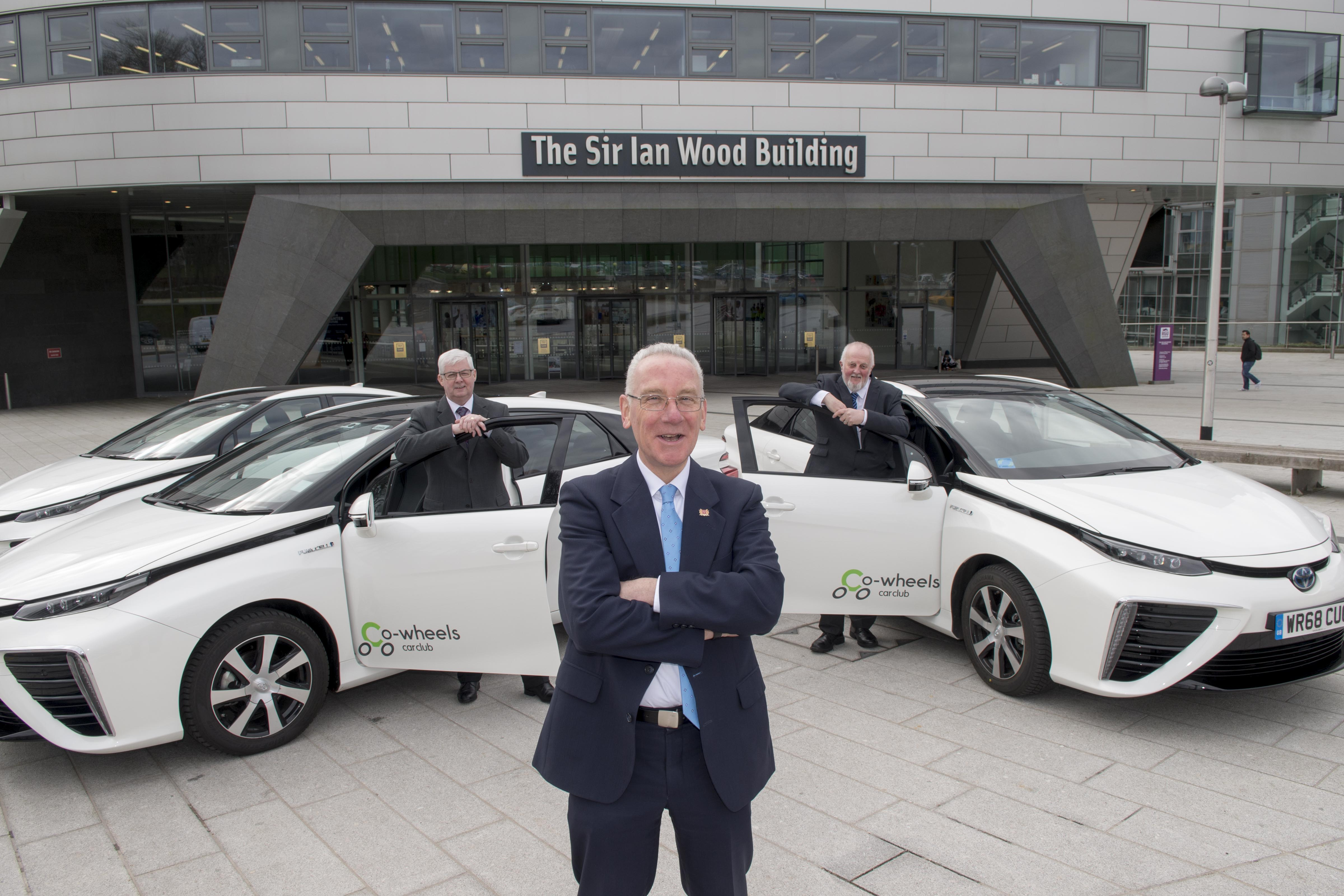 27/03/19 L-R Bill Somerville- RGU Director of Estates and Properties Services,Councillor Philip Bell, Aberdeen City Council's operational delivery vice convener, Co-wheels Car Club Scotland Manager Tony Archer  Aberdeen City Council's ambitious hydrogen programme is set to reach an even wider audience with the addition of the first two cars available for public use.The Toyota Mirai models will join the Co-wheels Car Club fleet in the city and will be available for club members to hire through the online booking system.The Mirai, winner of the World Car Awards' green car of the year award, uses hydrogen fuel cell technology to enable long-distance emission free motoring – with a range of about 300 miles.The cars have received EU Interreg North Sea Region funding through the Hydrogen Transport Economy (HyTrEc)2 Project in which Aberdeen City Council is a partner. This is part of the Aberdeen City Region Hydrogen Strategy and Action Plan 2015-2025 to develop a hydrogen economy in the region.The distinctive cars are already becoming a familiar sight on the Aberdeen roads, with the council already using the Mirai as part of its fleet.The two new additions to the public Co-wheels hire will be stationed at Gallowgate Car Park and East Craibstone Street from 1 April.Aberdeen has two hydrogen refuelling stations, at Kittybrewster and Cove, to support the growing fleet of cars, buses, and commercial vehicles operating in the city as part of the innovative programme.