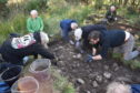 The researchers at the dig site