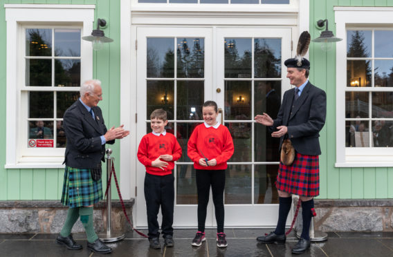 L-R: President of the Games, David Geddes, Lewis Mutch and Diamond Mackay of Braemar School and the Duke of Fife
