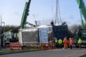 A lorry delivering material became stuck near Asda in Portlethen. Picture by Kath Flannery.
