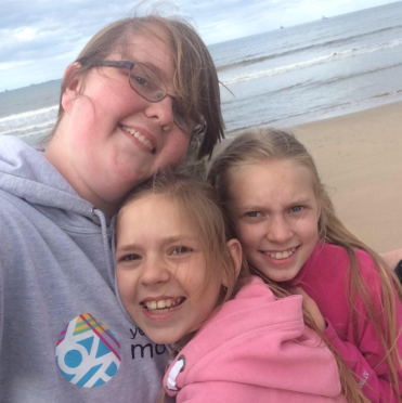 Emily Burns with Vika and Alina, who she hosted in Moray from Belarus.