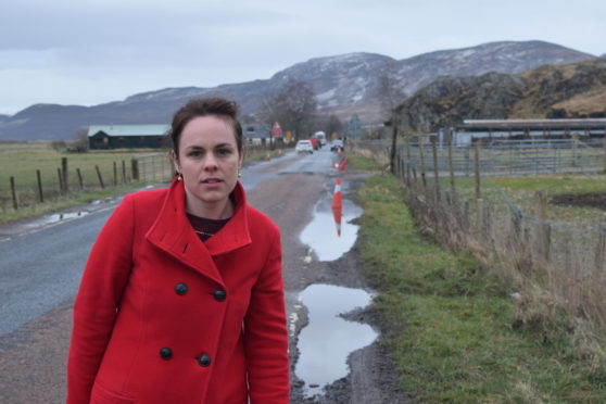 Kate Forbes MSP at the stricken road surface near to Laggan