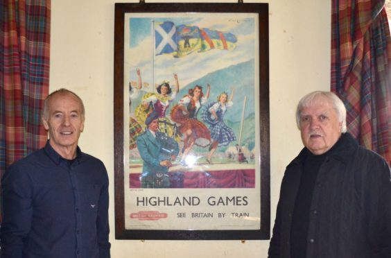 Alistair Grant (left) chairman of Aboyne Highland Games and committee member Wilson Forbes with the poster